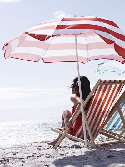 matching red and white striped beach chair and beach umbrella