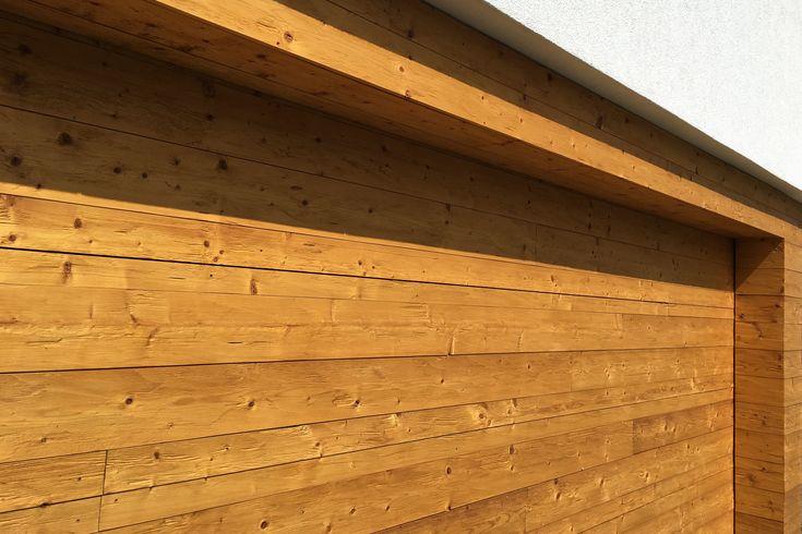 Hörmann Garagentor mit Holz verkleidet