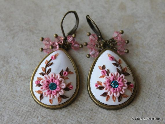 Check out this item in my Etsy shop https://www.etsy.com/listing/474765398/polymer-clay-applique-floral-statement