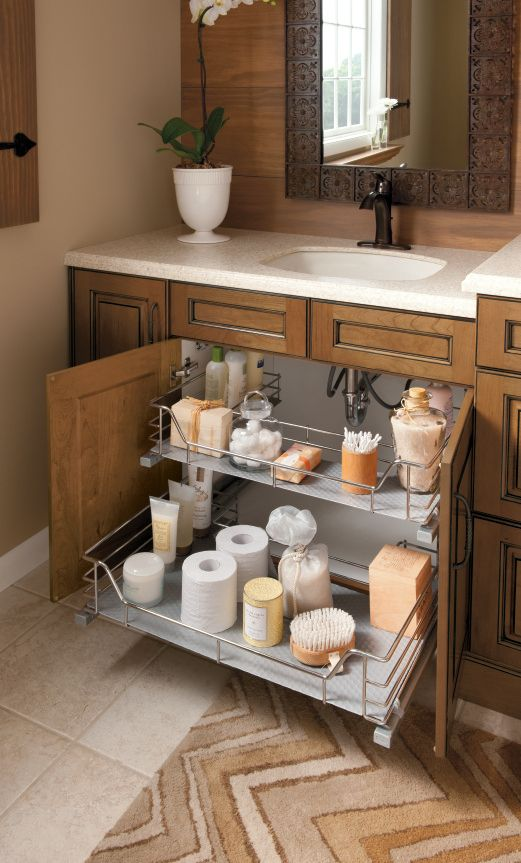 A great solution to a common problem! This vanity sink base slideout by Kitchen Craft allows for ultimate bathroom organization.