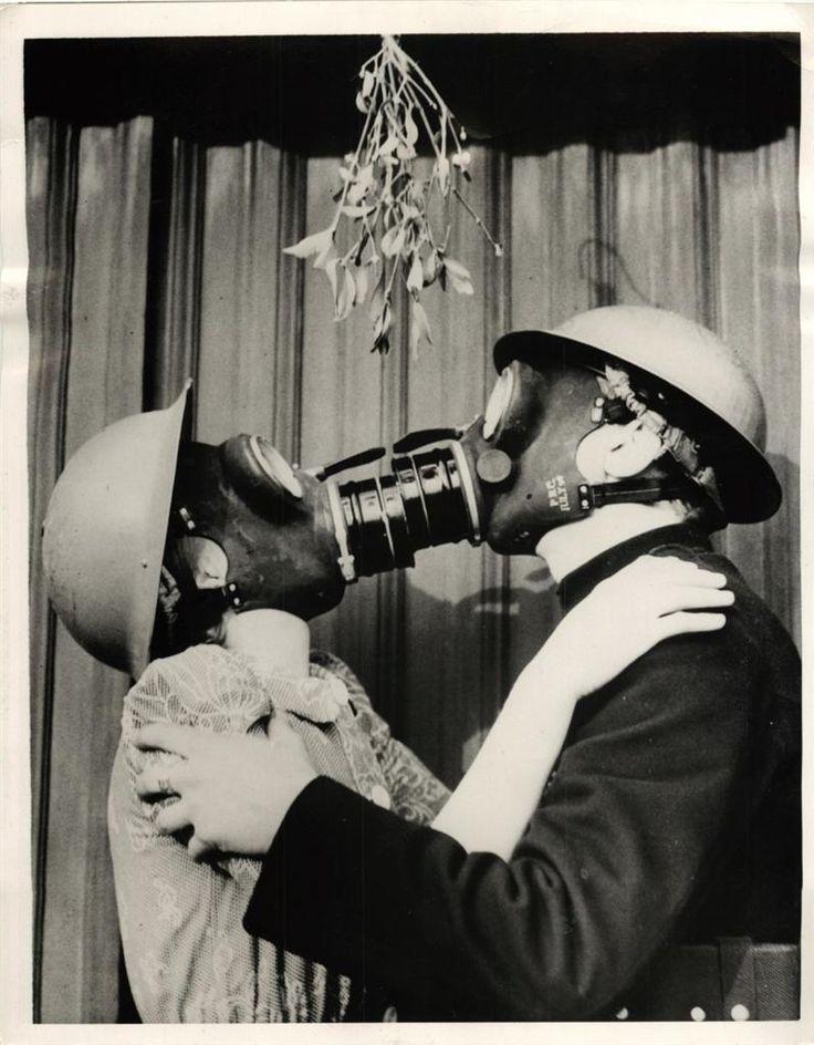 Gas masked kissing under the Mistletoe. England 1940