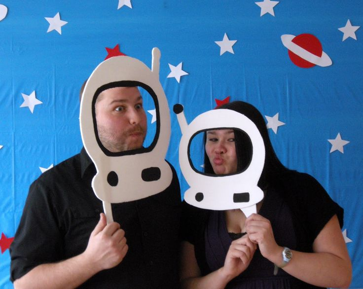There were (dollar store foam-core board) cut-outs of astronaut helmets, like these: