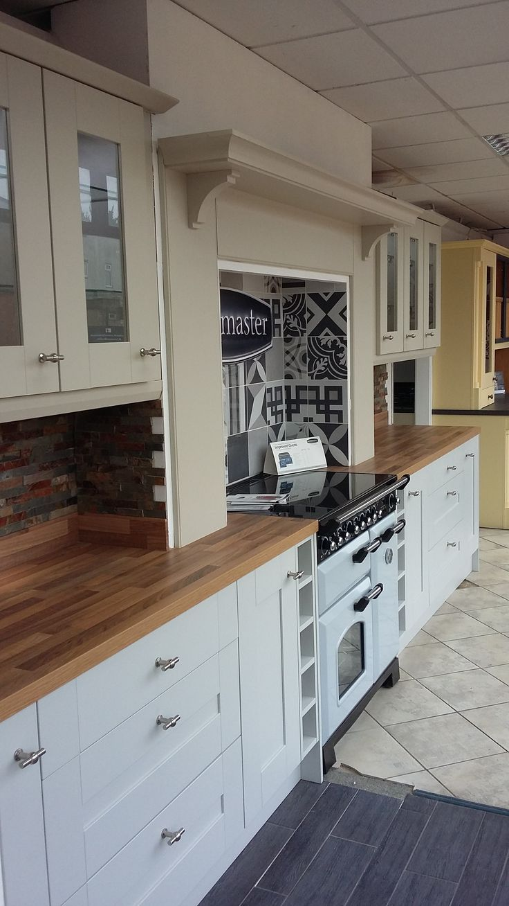 BY DESIGN Longford Shaker Kitchen with Natural Blocked Walnut Laminate Worktops on display in our Bridport, Dorset Showroom