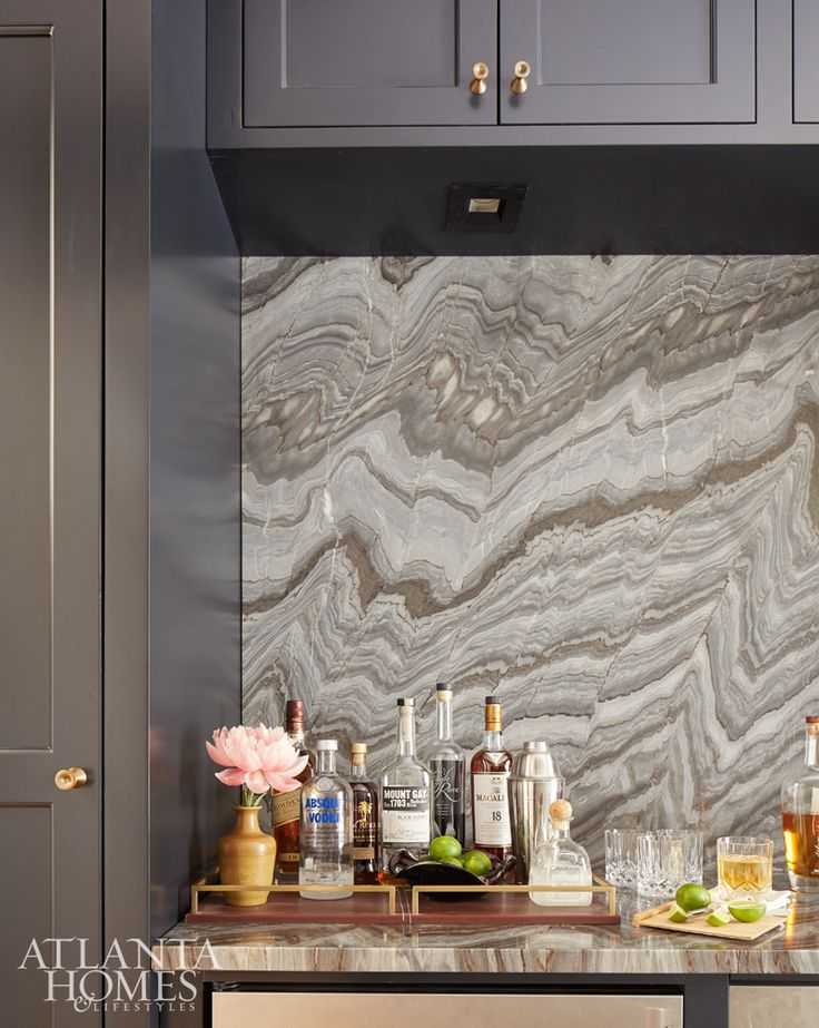 stone pattern on counter and wall in this newly built fl home designed by