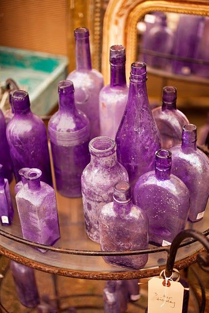 Antique glass bottles! I love antique bottles and have never seen purple ones?!?! Makes me wonder if they are a replica of real antiques?