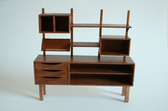 "Here is an elegant centerpiece for your mid century dollhouse or room box. A unique, handcrafted standing shelving unit in 1:12 scale.    Materials include cherry & basswood. 5"" tall."