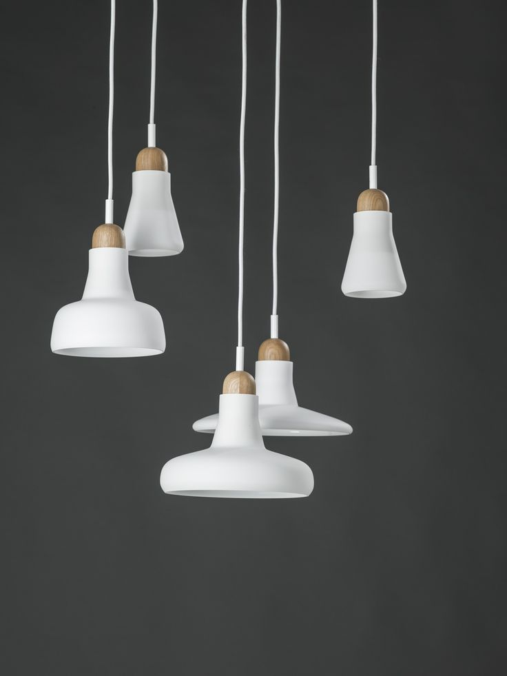 Black interior - Brokis lights - White Shadows are hanging lights. The designer Lucie Koldova and Dan Yeffet.