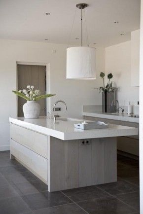 pale contemporary kitchen with grey tiled floor