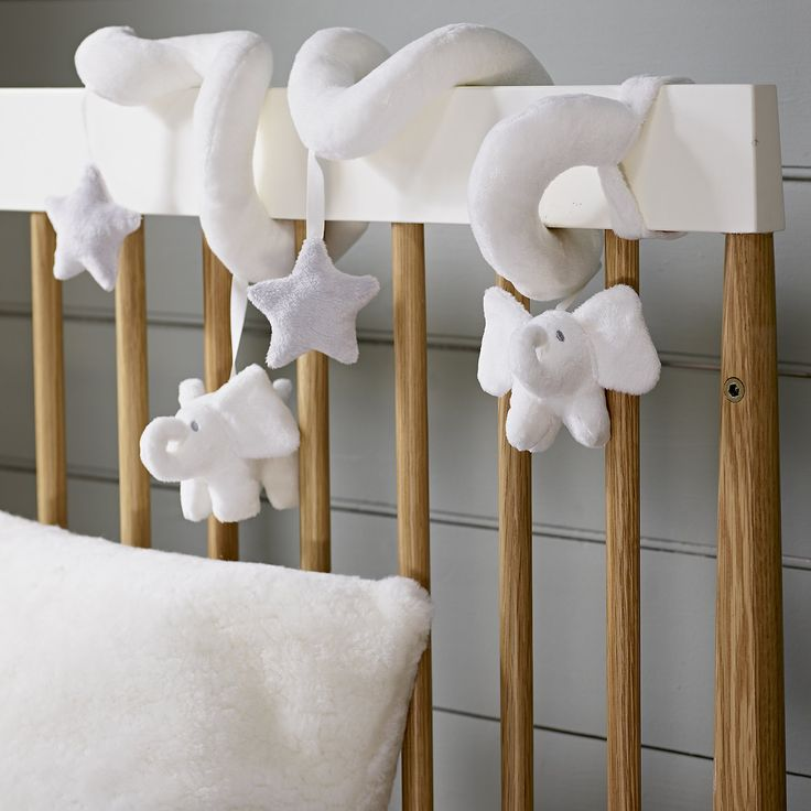 Baby shower gift ideas: The White Company Spiral Indy Cot Toy - White Grey elephants stars