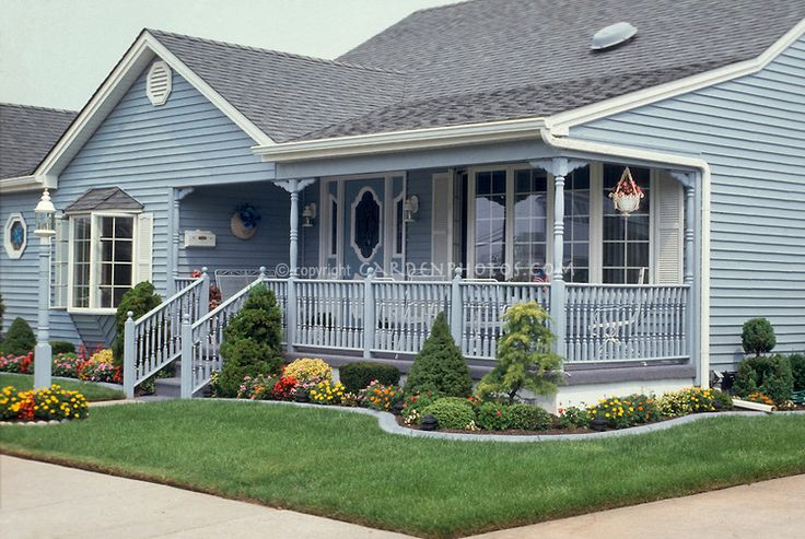 Curb appeal blue house lawn foundation plantings for Front porch landscaping plants