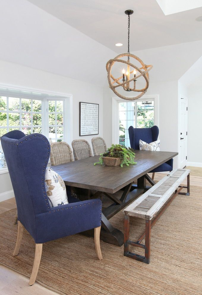 Cool wingback dining chair in Dining Room Beach Style with Dunn Edwards Gray Wolf next to Nautical Lighting alongside High Back Chairs and Mismatched Dining Chairs
