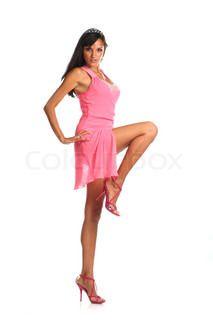 Voller Länge Brünette Frau in rosa Kleid posiert   Stock-Foto   Colourbox on Colourbox