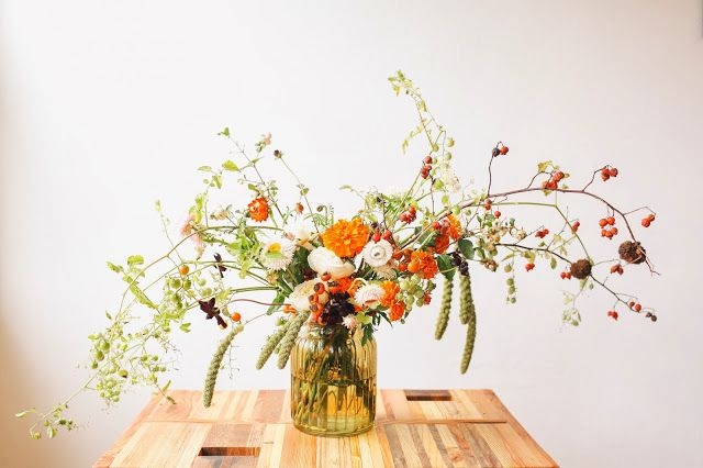 The Green Dandelion // Floral Design & Botanical Styling: marigolds and tiny tomatoes