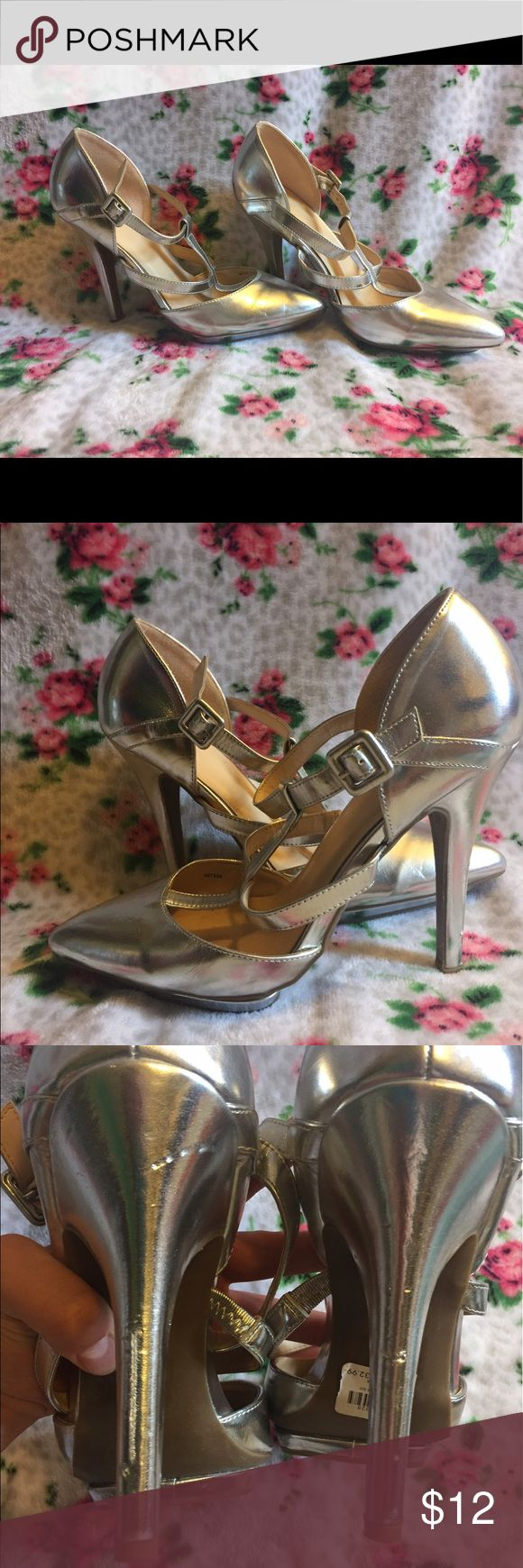Silver Charlotte Russe Heels Size 9! Hello to all you heel lovers! I'm selling a pair of SILVER metallic looking Charlotte Russe heels, SIZE 9. They have some nicks and scratches(as seen in photos). I'm asking $12 obo:) Charlotte Russe Shoes Heels