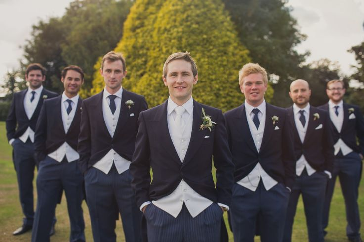 Traditional Morning Suits / Tails - Bride in a San Patrick Wedding Dress at a traditional wedding in Woolverstone Hall Suffolk. Bridesmaids wear Pink Two Birds dresses and groom in Navy Morning Suit