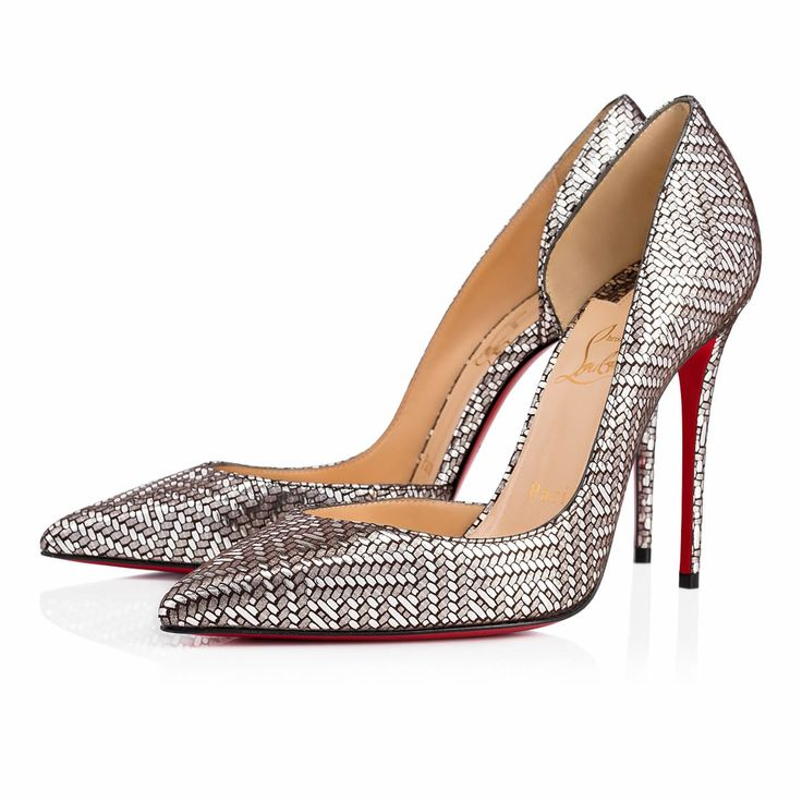 "Christian Louboutin's signature half d'Orsay, ""Iriza,"" is a stunning look for women who aren't afraid to be a little bit exposed. Her cut-out vamp creates a sexy and utterly feminine shape. This 100mm antique silver gourmette chain print version is the perfect Fall/Winter statement pump."