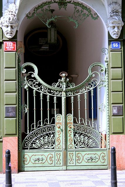 Prague, Czech Republic!!! Bebe'!!! Love these two mint green ironwork gates leading into the entrance hall!!!