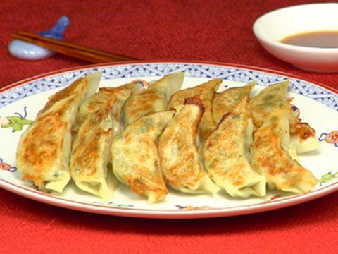 Gyoza! Video is helpful For seeing the folding technique. Inexplicably, there is a dog in this cooking video.