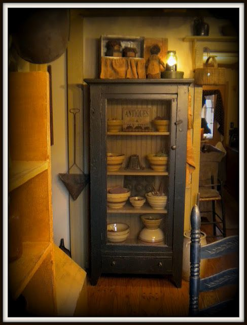 love the cupboard......can put screen or chicken wire on front in place of glass