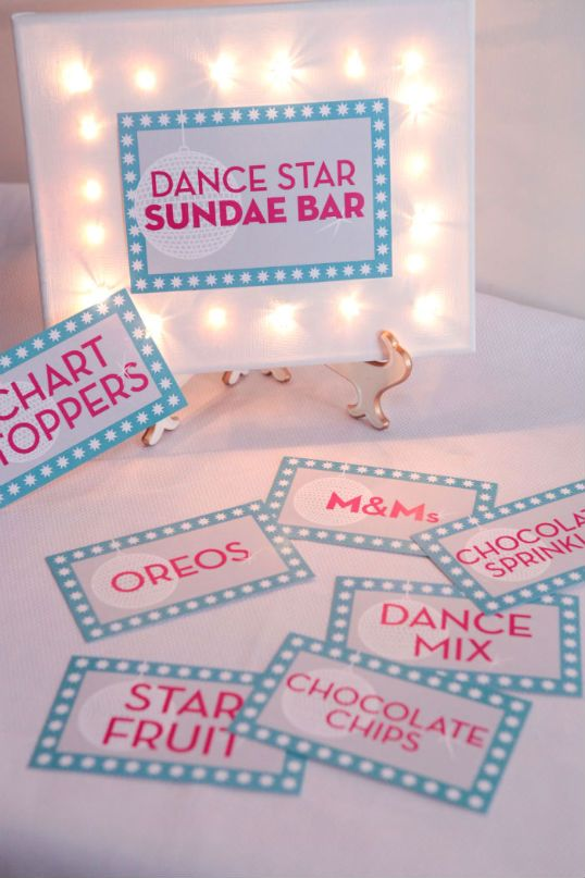 use string lights to light up your signs at a rock star party