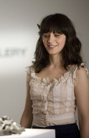 Zooey Deschanel's Cream ruffle top from 500 Days of Summer.  Outfit Details: http://wwzdw.com/z/1693/ #WWZDW
