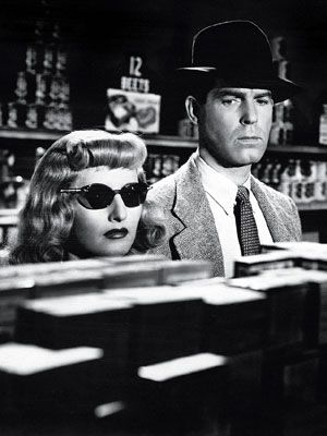Barbara Stanwyck in 'Double indemnity'. Can't he see she's out to get him? Maybe it's the sunglasses....
