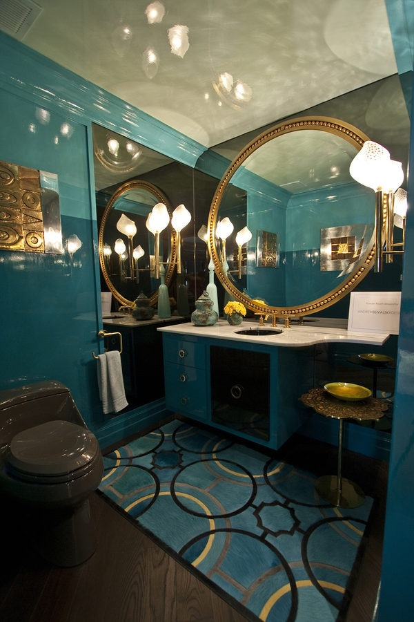 Turquoise powder with large round gold mirror