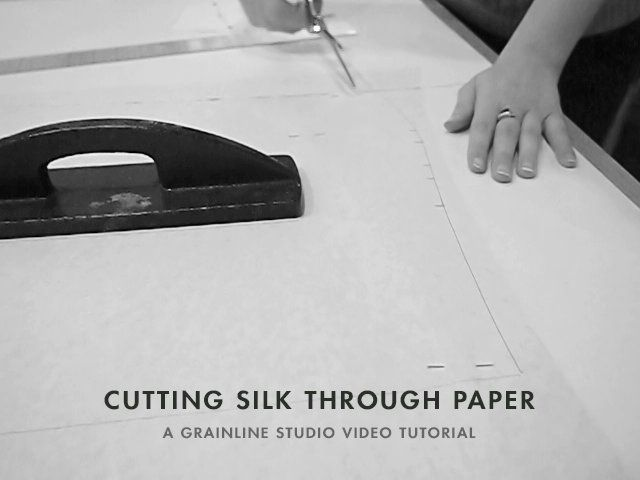 Cutting Silk Through Paper by grainline. Demonstrating how easily you can cut silk when it's layered between to sheets of paper.