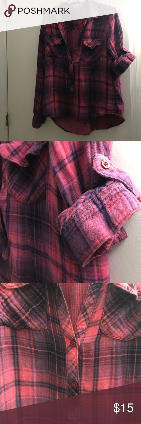 Flannel very low cut. there is a button missing. two pockets on the front. sleeves have option to roll them up or keep them long. very comfy. the brand is cloth and stone. bought it from south moon under. Tops Button Down Shirts