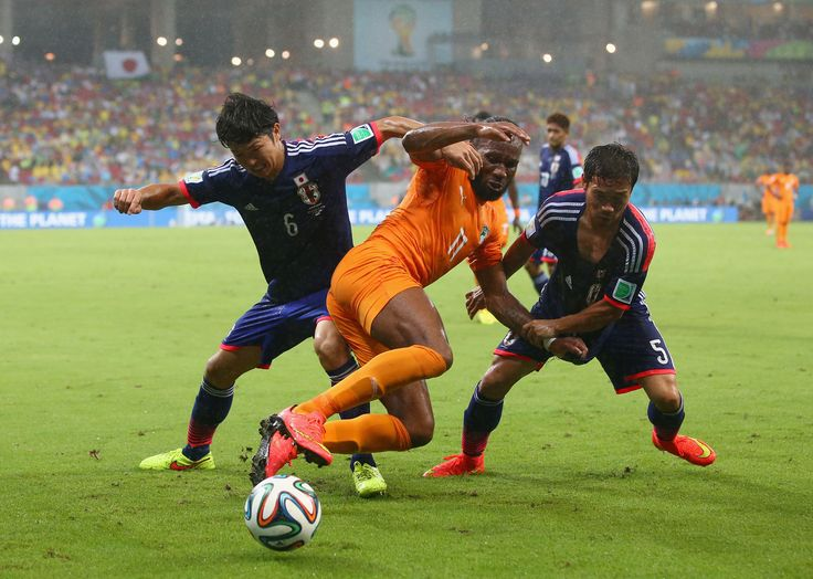 Masato Morishige (L) and Yuto Nagatomo of Japan challenge Didier Drogba of the Ivory Coast during the 2014 FIFA World Cup Brazil Group C match between the Ivory Coast and Japan at Arena Pernambuco on June 14, 2014 in Recife, Brazil. (Photo by Julian Finney/Getty Images)