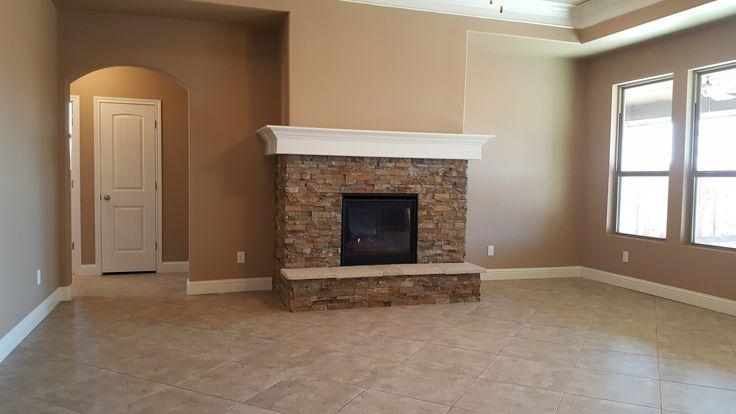 A 'Chiara' family room: VeneerStone fireplace (Savoy), Brown Tee Pee walls, Polar Bear trim, MA92 tile in diamond pattern