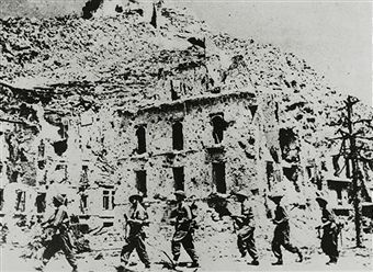 War and Conflict, World War II, Italy, pic: 1944, An Allied Polish patrol marches through the streets of Cassino, the scene of bloody fighting between the Germans and Allied troops for Monte Cassino - pin by Paolo Marzioli