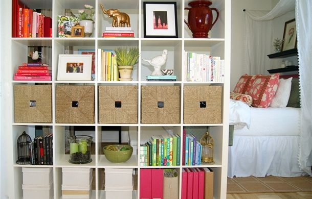 Share Space fan uses EXPEDIT bookshelf as a room divider in a studio with DIY stylish gold patterned sides!