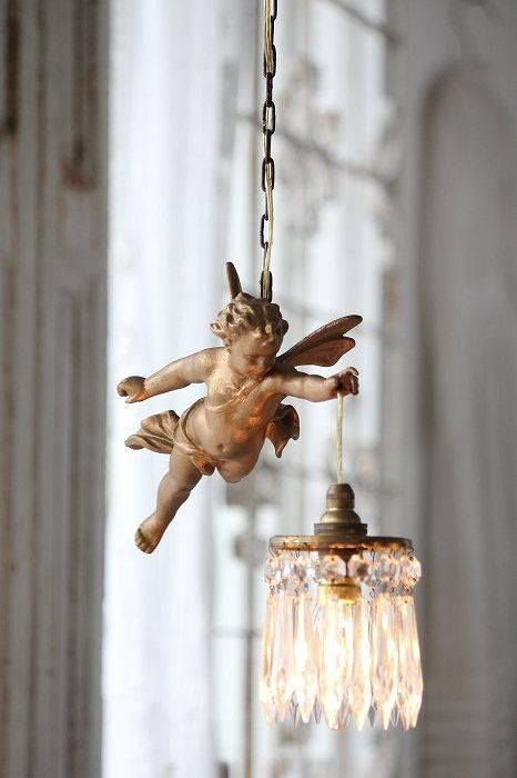 Cherub holding crystal light - perfect in a high ceiling room