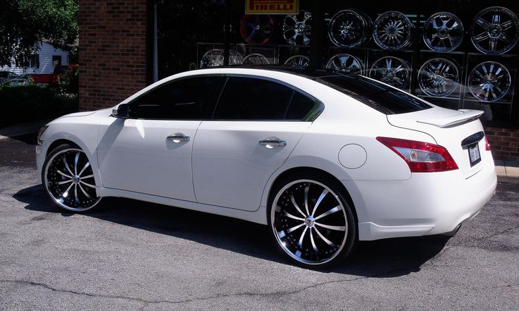 Lexani Wheels, the leader in custom luxury wheels.  White 2011 Nissan Maxima with machine and black LSS-10