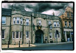 """The Angel and Royal. Grantham. Anyone staying here will be within the walls of one of England's most historic buildings. It should therefore come as no surprise to learn that somewhere so very ancient should possess a ghost or two. These include a slender """"white lady""""; a spook called """"Jasper""""; and some mysterious lights . The Grey Lady - Drifting down the corridors of the upper regions of the building, this figure may be responsible for the poltergeist like actions in one of the bedrooms"""