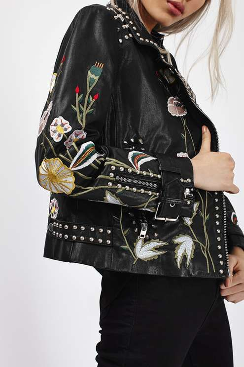 Embrace your inner fashion chameleon with this embroidered leather jacket, as seen on our campaign girl Taylor Hill! Feminine meets biker girl, this jacket features both floral and studded detail for a contrasting feel. Comes with an asymmetric zip up fastening. #Topshop
