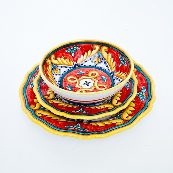 Dinnerware set hand painted with blue, yellow and red geometric design. #madeinItaly #Gift #ChristmasIdeas Click on the image to learn more about the these plates.