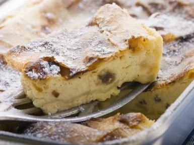 Curd cheese strudel in baking tin with piece on server - Foodcollection / Getty Images