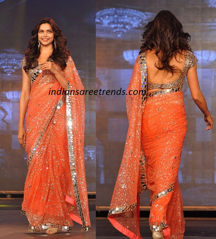 Latest Traditional and Designer Sarees: Deepika Padukone in orange color shimmer saree