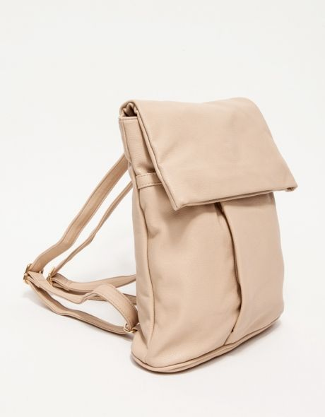 Manmade leather, midsize backpack with fold over magnetic closure details. Features a spacious top pocket with zipper closure, fold over flap to main pouch, adjustable shoulder straps, loop handle, front and rear outer zip pockets, hidden vertical pocket,