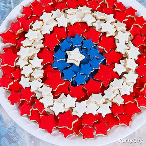 Arrange red, white and blue star-shaped cookies on a round platter to make Captain America's shield.