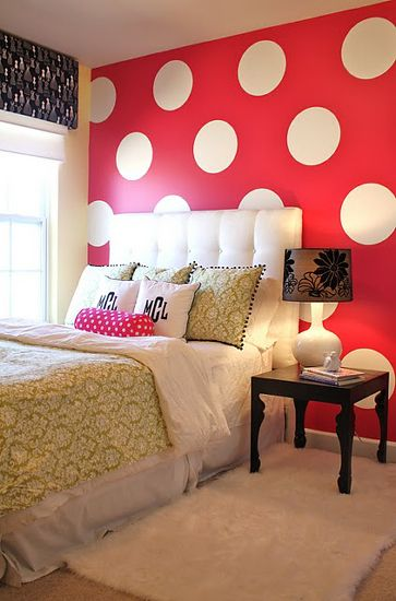 I don't think I could paint a wall red, but I'm inspired to find polka dot bedding!