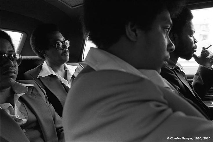 B.B. King Band, Boston, Massachusetts, 1979. Here, Calep Emphrey (drums), Joe Turner (bass), Walter King (saxophone), and Eddie Rowe (trumpet) of the B.B. King Band are riding in the limo from their hotel to a performance at a Boston TV station. Walter King, right/foreground still travels with B.B., who is his uncle. Now he's the bandleader, but in the 1970's Walter King was the junior member.