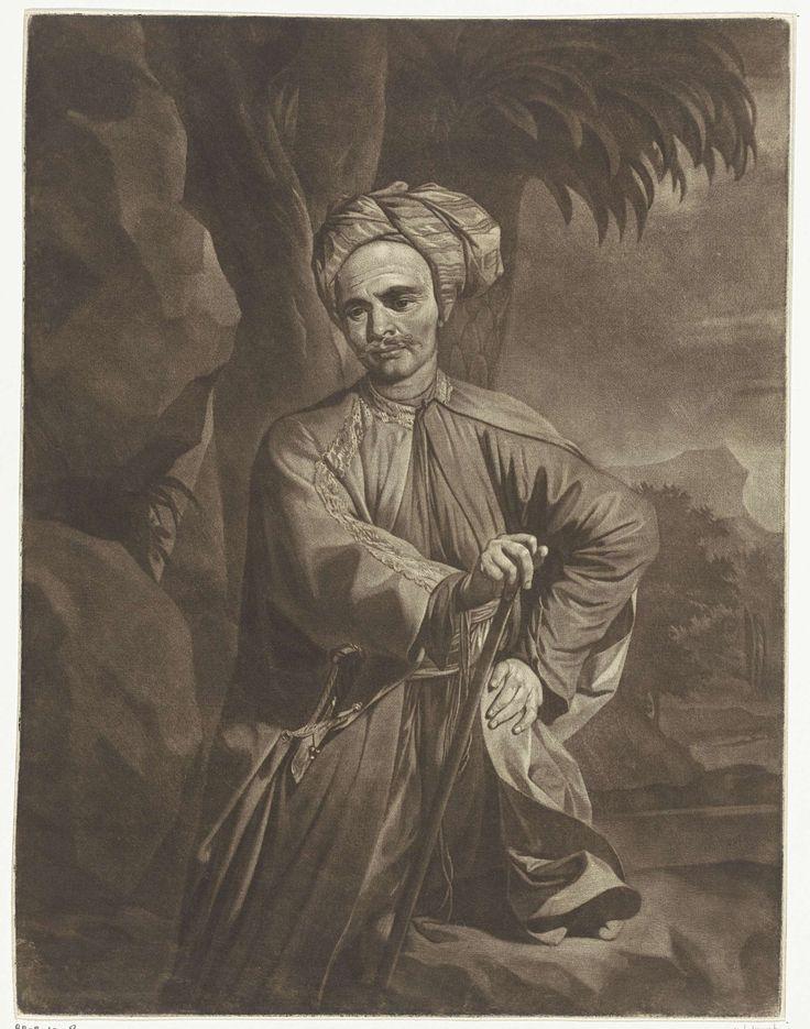 Arnout Rentinck | Portret van een Oosterling met een tulband, Arnout Rentinck, 1722 - 1775 | Onder een boom staat een man met een tulband, een zwaard en een staf. Hij staat naast een rotsformatie. Op de achtergrond rotsen en palmbomen.