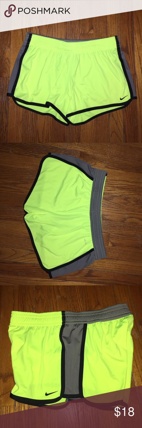 Nike Athletic Shorts in Bright Yellow These comfortable running shorts are perfect for any active lifestyle! With a near neon yellow base, grey panels, and black piping, they are sure to make you stand out on your morning run! In perfect condition, no stains or pills, only worn twice! Nike Shorts