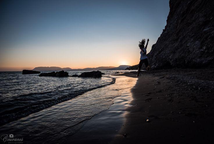 Woman dancing in Dafni beach, Zakynthos (Zante) island.