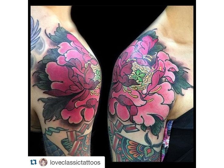 Japanese tatto on woman's shoulder, big flower