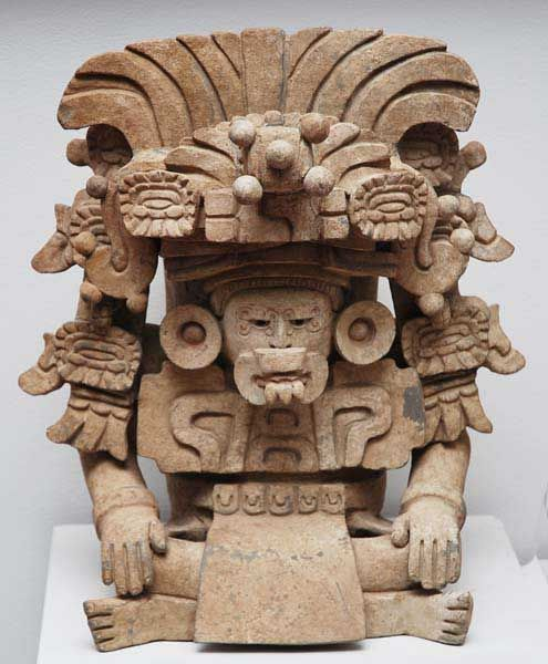 Zapotec. Urn of The god with thw Bow-Knot in his headdress. Possibly the Zapotec version of the Maya God L. The Bow-Knot is actually his hair which is doubled back. Ht 47 cm