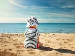 58642457 25 Beach Hacks for Toting Baby to the Shore | Baby | Baby sun hat ...
